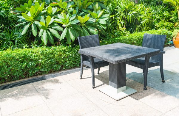 Outdoor patio with empty chair and table